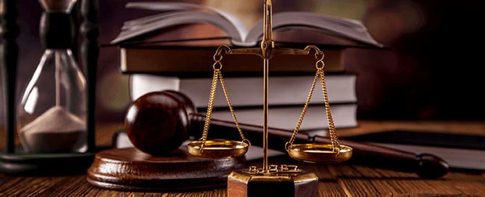 Scales of justice, law books and gavel