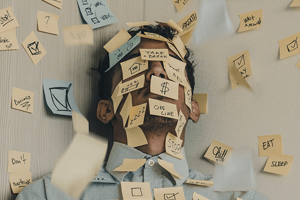 A man with lots of post-it notes