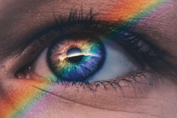 A human eye and a rainbow